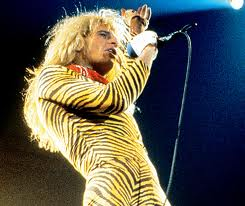 David Lee Roth sings while wearing 1980s-style body suit.
