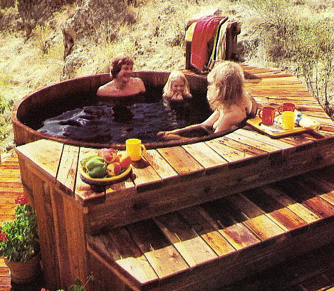 Family sitting in hot tub.