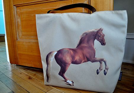 A tote bag with a horse on it.