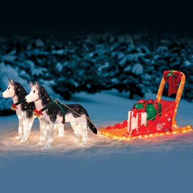 Light up huskies pulling a sleigh.