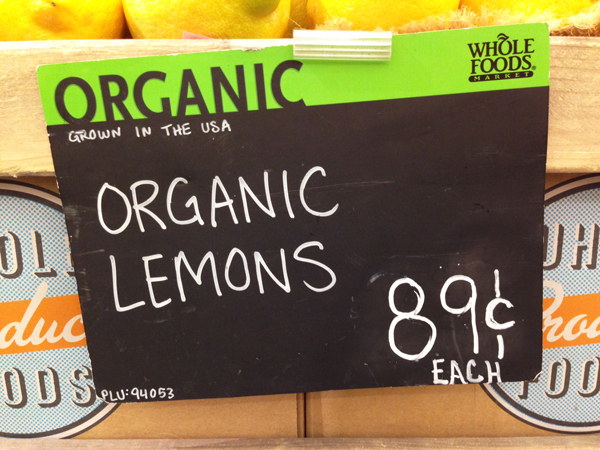 Whole Foods sign for organic lemons 89 cents each